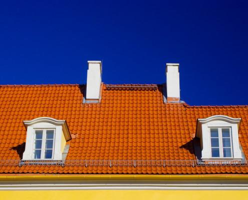 orange roof against blue sky