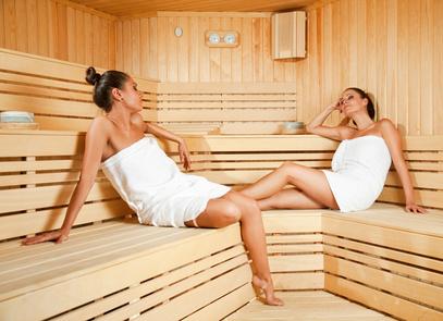 Females relaxing in sauna